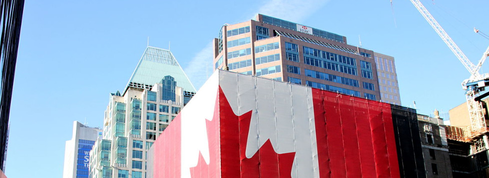 Building wrapped in gigantic canadian flag