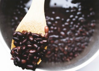 Black beans on a wooden spoon